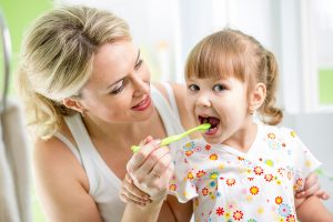 The-Gap-Dental-Mother-Teaching-Child-Daughter-tooth-brushing